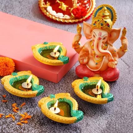 4 Mango Shaped Diyas and Pink Dhoti Ganesha Idol: Gifts for Boss