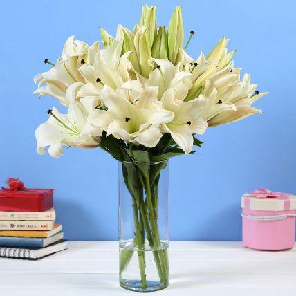 6 White Oriental Lilies in Glass Vase